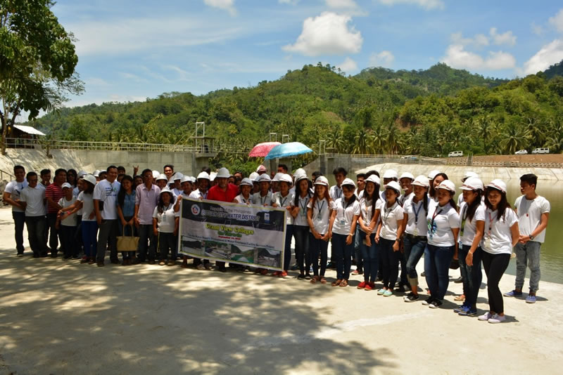 Scholars, staff and faculty of Grand View Colleges (GVC), headed by its president Manuel A. Esteves, pose for posterity during their visit recently to the project site of the Taguibo Water Supply Development and Water Treatment Facility Service Project (T